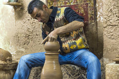 Potter works with clay in ceramics studio. Royalty Free Stock Photos