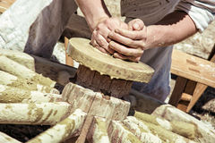 Potter works manually on the pottery wheel Royalty Free Stock Photo