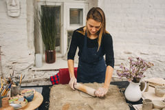 Pottering process.Dirty hands creating dishes Stock Photography