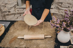 Pottering process - Dirty hands creating dishes Stock Images