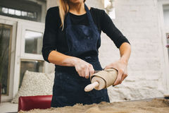 Pottering process.Dirty hands creating dishes Royalty Free Stock Photos