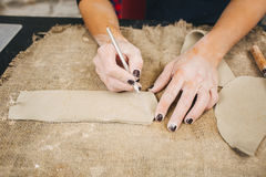 Pottering process.Dirty hands creating dishes Royalty Free Stock Image