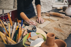 Pottering process.Dirty hands creating dishes Royalty Free Stock Photo