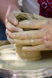 Potters hands Stock Photography