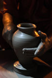 Potters hands. Closeup shot of potters hand giving shape to clay vessel Royalty Free Stock Image