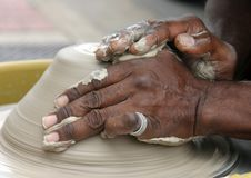 Potters Hands. A potter shaping clay on potters wheel Royalty Free Stock Photography
