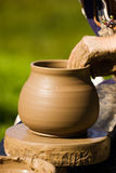 Potters hands Stock Images