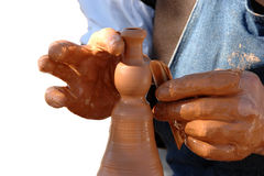Potters hands creating a clay vase Royalty Free Stock Photos