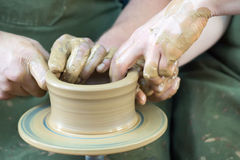 Potters hands Stock Photos