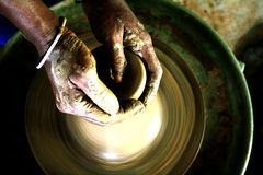 The potters hands. A lady potter working on pottery in rural india royalty free stock photo