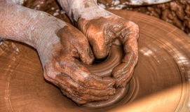 Potters hands. Hands of a potter shaping a vase on a potter's wheel Royalty Free Stock Photos