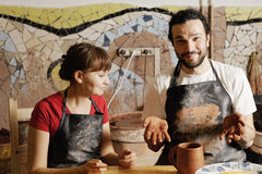 Potters with jug Stock Photos