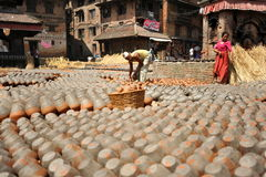 Potters square. Potters dry their pottery on the square in Bhaktapur Royalty Free Stock Images