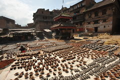 Potters square. Potters dry their pottery on the square in Bhaktapur Stock Images