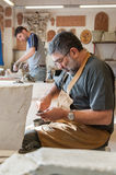 Potters at work. In their workshop Stock Photos