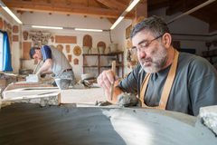Potters at work. In their workshop Stock Photo