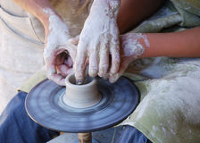 Potters working by the throwing wheel Stock Images