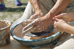 Potters working by the throwing wheel Royalty Free Stock Photos