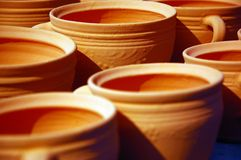 Pottery. Clay pots in a row staying to dry in the sun stock photo