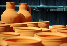 Pottery. Clay jugs and bowls staying to dry in the sun stock photography