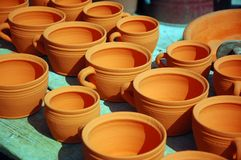 Pottery. Clay pots and bowls staying to dry in the sun royalty free stock image
