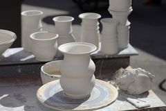 Pottery. Hand-made Clay pots in sunlight Stock Photo