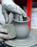 Pottery. Image with hands making pottery Royalty Free Stock Photo