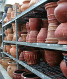 Pottery. Shelves of large pottery inside a greenhouse and nursery stock photos