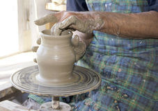 Pottery. The creation of pottery on wheel Royalty Free Stock Photo