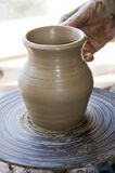 Pottery. The creation of pottery on wheel Royalty Free Stock Images