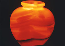 Pottery. Iluminated on a black background Stock Images