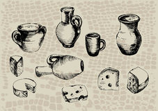 Pottery. Jug with milk and a slice of cheese Stock Images
