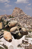 Pottery. Artisanal pottery in Cappadocia, Turkey, with the town of Uchisar in the horizon Stock Photography