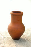 Pottery. Clay pottery- earthenware pot on table Stock Photo