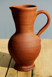 Pottery. Clay pottery -jug on wood table Stock Image