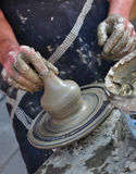 Pottery. Close-up photo of hands making pottery on a wheel Royalty Free Stock Image