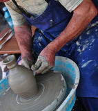 Pottery. Close-up photo with a man making pottery on a wheel Royalty Free Stock Photography