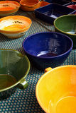 Pottery. A selection of various shapes and colors of pottery for sale at a market Royalty Free Stock Photos