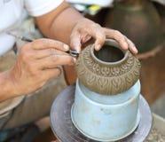Pottery. Countryman Create Thai Pattern on Pottery Royalty Free Stock Photos