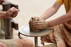 Pottery art. Potter teaches the student to his art Royalty Free Stock Images