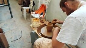 Pottery artist making clay pot at the 12th International Eskisehir Terra Cotta Symposium. Eskisehir, Turkey - September 04, 2018: Pottery artist making clay pot stock video