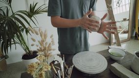 Pottery artist works with raw clay stock video footage