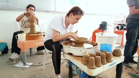 Pottery artists making clay pot at the 12th International Eskisehir Terra Cotta Symposium. Eskisehir, Turkey - September 04, 2018: Pottery artists making clay stock footage