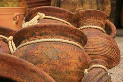 Pottery background with rope ties. Pottery with ropes tied below the rim Royalty Free Stock Images