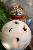 Pottery Ball. And frog in the garden Stock Photos
