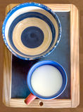 Pottery bowl and cup milk on the blackboard Royalty Free Stock Images