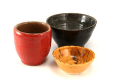 Pottery Bowls. Yellow. red and dark green  pottery bowls on a white background Royalty Free Stock Photos