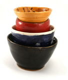 Pottery Bowls. Yellow. red, blue and dark green  pottery bowls stacked Stock Photography