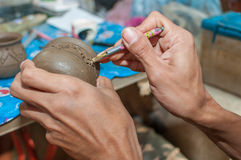 Pottery carving in hand. Pottery is a delicate and requires skilled in the art they made royalty free stock photography