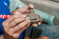 Pottery carving in hand. Pottery is a delicate and requires skilled in the art they made Royalty Free Stock Image